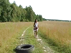 A Fantastic Slim Girl Walks in the Field by snahbrandy