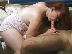 Redhead granny gets busy