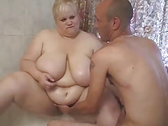 BBW girl sucking during shower