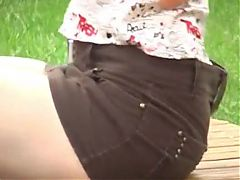 Girl Lying Park Showing The Upskirt
