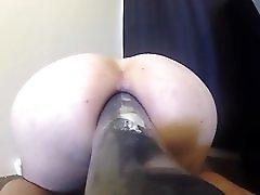 Girlfriend Shoving Huge Dildo In Her Ass