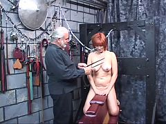 Bondaged Redheaded Slave Gets Her Tits Clamped Tight