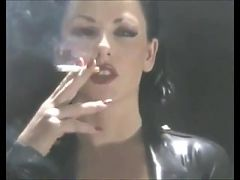 Smoking Brunette In Rubber