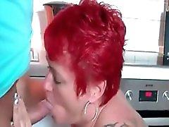 Pierced And Tattooed Granny Sucking Cock