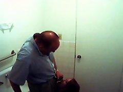 Fake Spy Redhead Gives Old Man Head In Bathroom